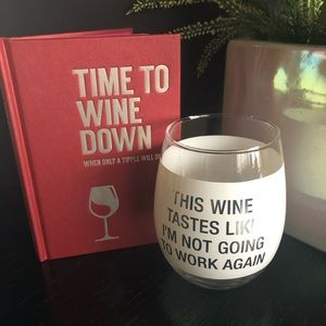 Wine glass and wine trivia book
